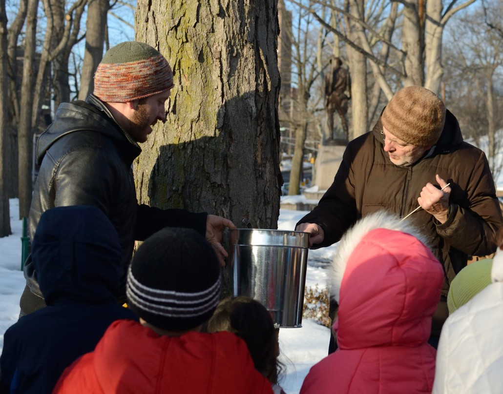 138044 CLIFFSIDE PARK, NJ MAPLE SUGARING DEMONSTARTION 2-25-15 Ed and Daniel Bieber of The Nature Place Day Camp demonstrated maple sugaring at the Cliffside Park Public Library on Feb. 25, 2015. KRYSTI SABINS/FREELANCE PHOTOGRAPHER