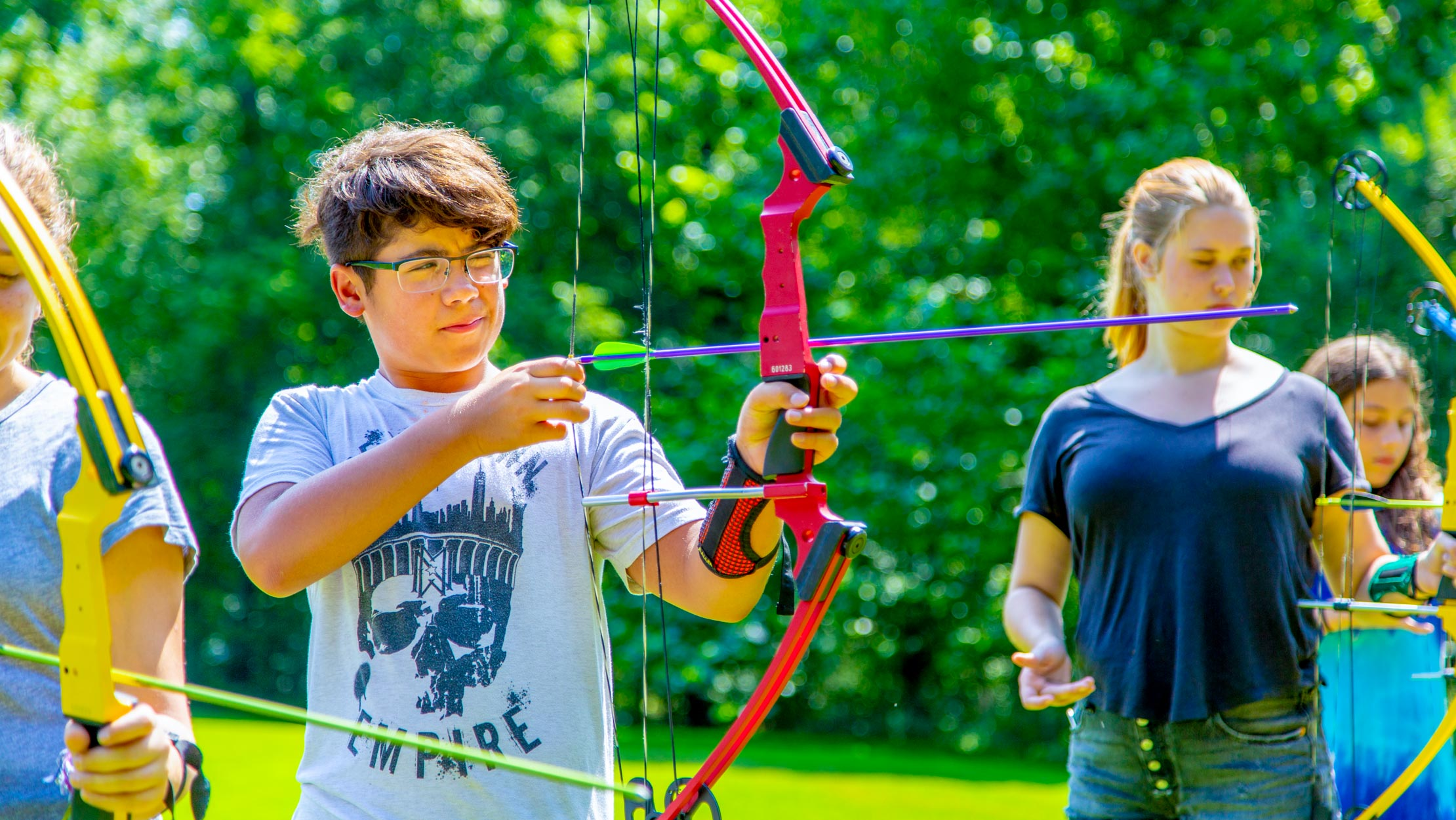 Campers learning archery