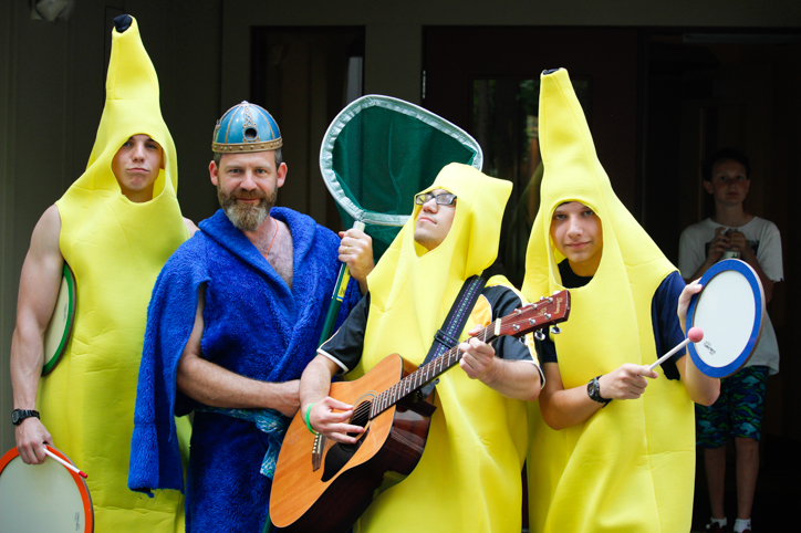 Counselors dressed in banana costumes playing the guitar