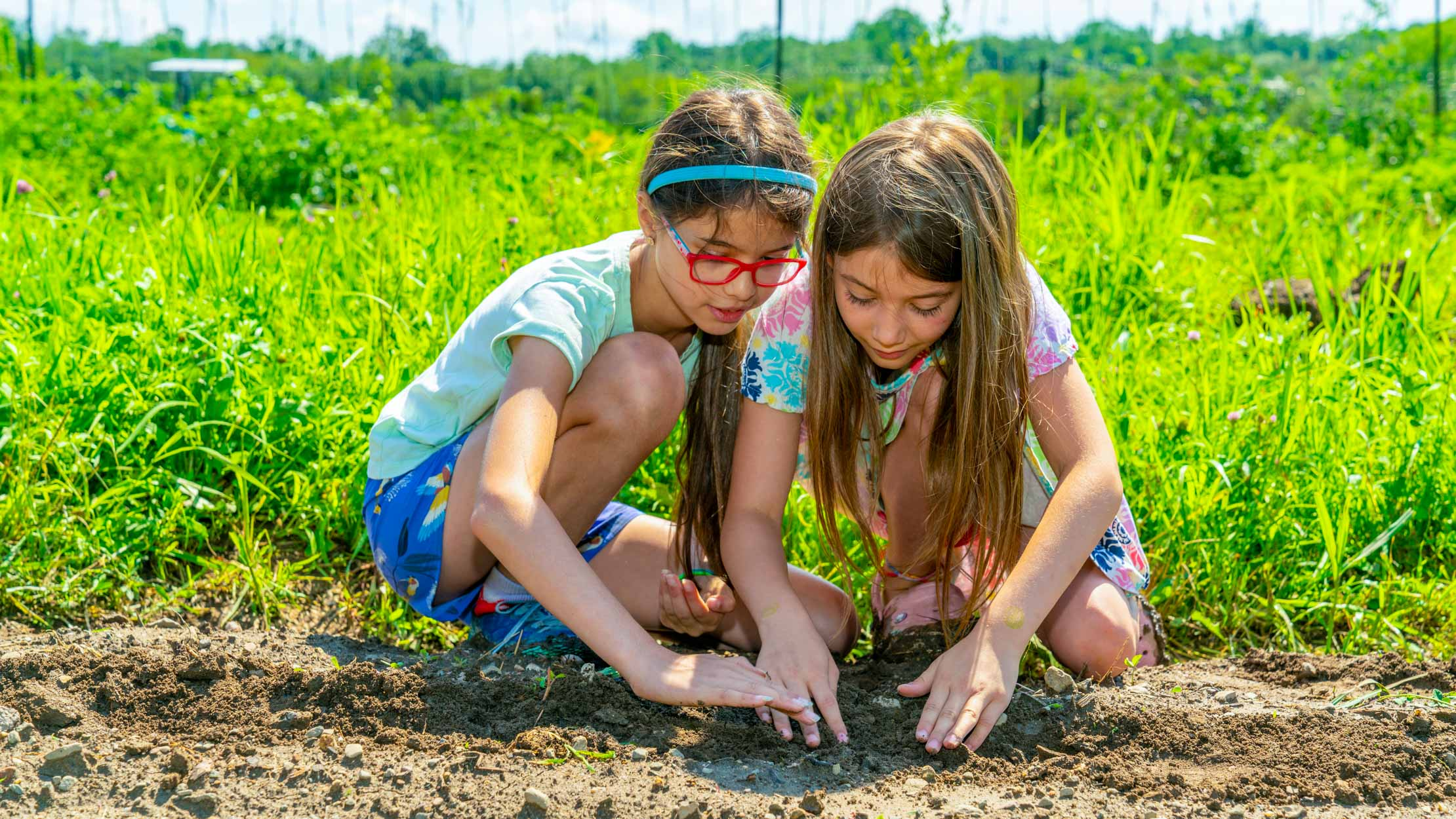Two campers planting seeds