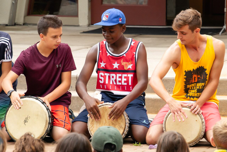 Campers playing on drums