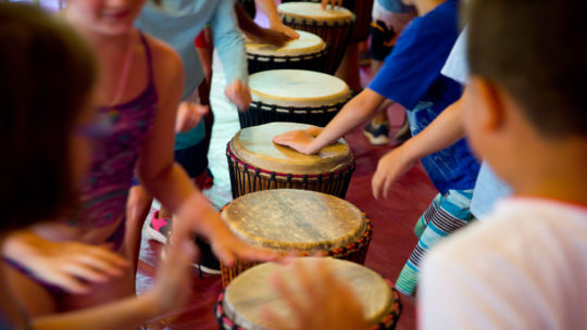 Campers drumming on drums