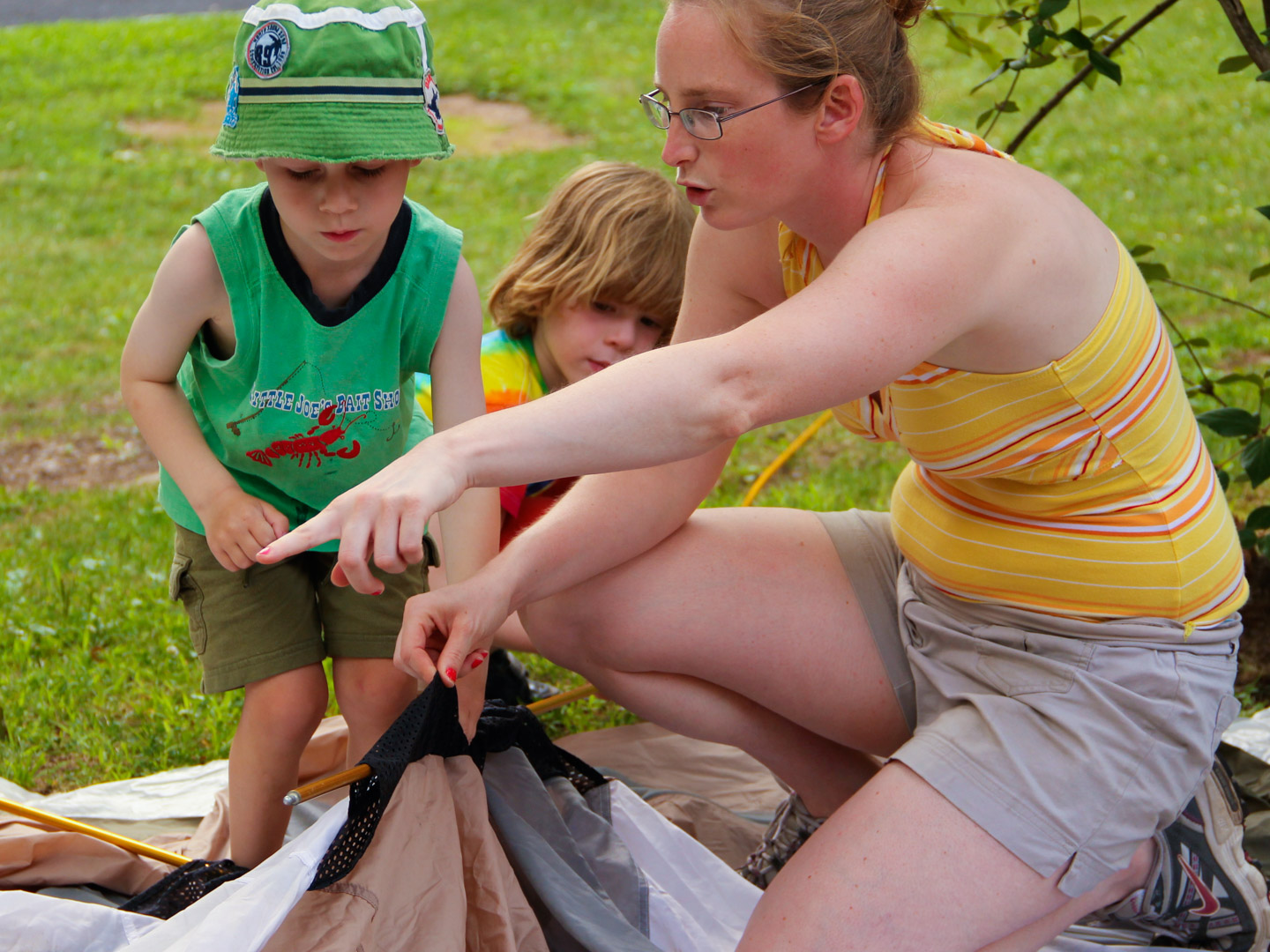 Young campers learning to put up a tent