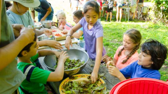 Campers making salads