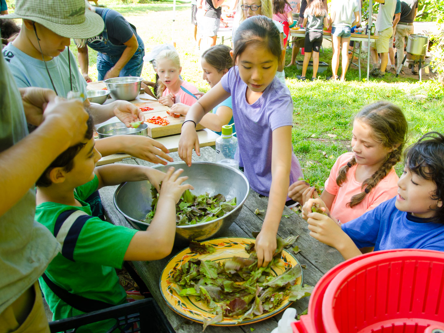 Campers making salads
