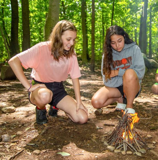 Two campers starting a fire