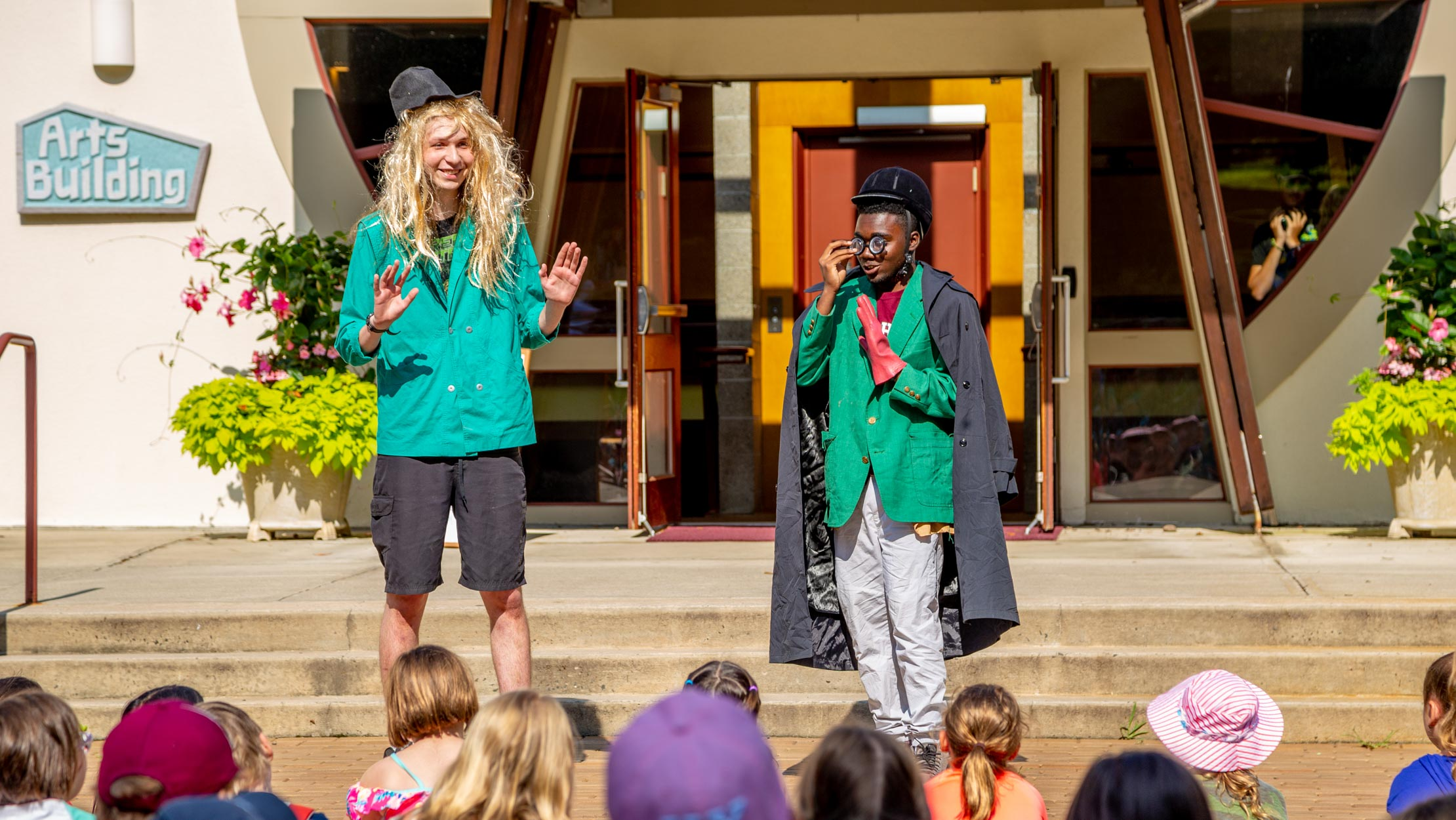Counselors dressed up performing a skit for campers