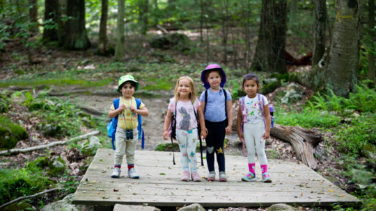 Young campers standing on a bridge
